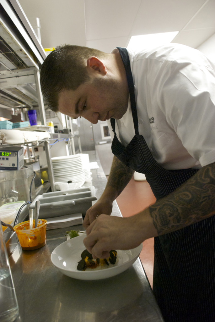 Chef Michael Corvino in The American Restaurant kitchen.