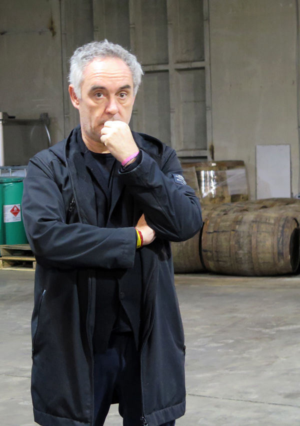 Chef Ferran Adria in front of barrels used to age J. Rieger whiskey.
