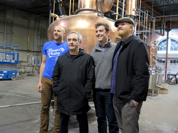 J. Rieger's dream team poses with Ferran Adria in front of their copper still.