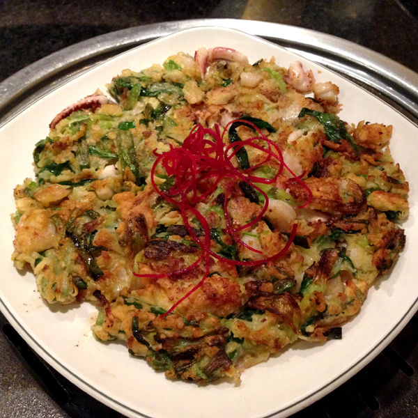 A savory seafood scallion pancake from a separate visit.