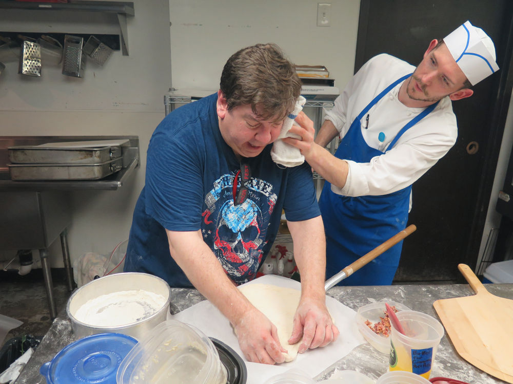 Craig Jones getting wiped down by Chef Gray Washburn.