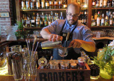 Pouring a Farmers Market cocktail.