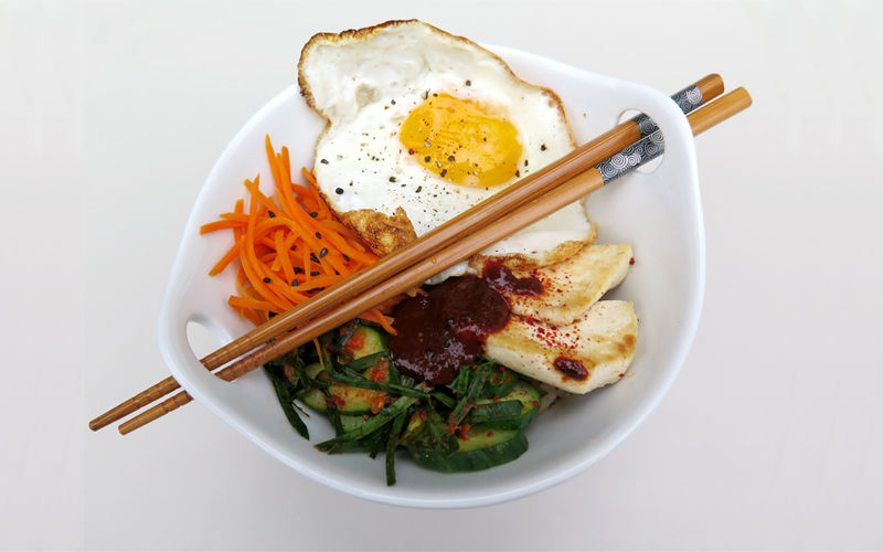 Gochujang with bibimbap, a mixed vegetable dish served with rice.